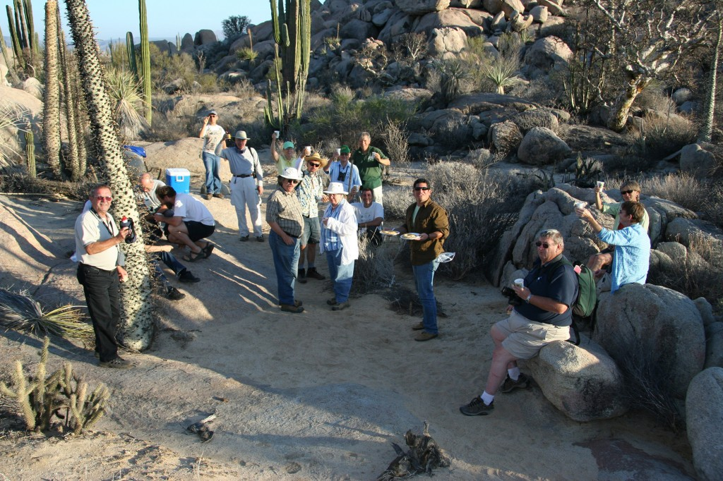Participants of the 2007 Post-Convention Tour to Baja California enjoy sundowners in the Cataviña boulder field. Photo D. Mahr.